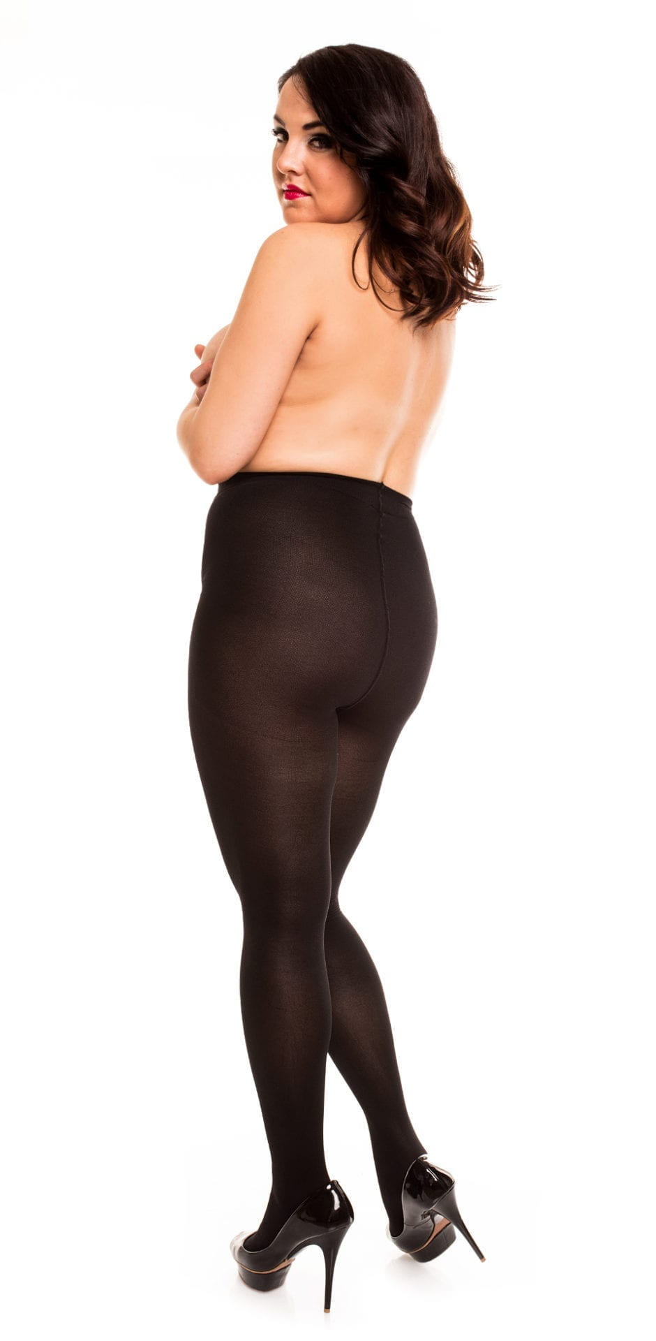 Plus size model wearing Glamory vital 70 support tights in color black back view