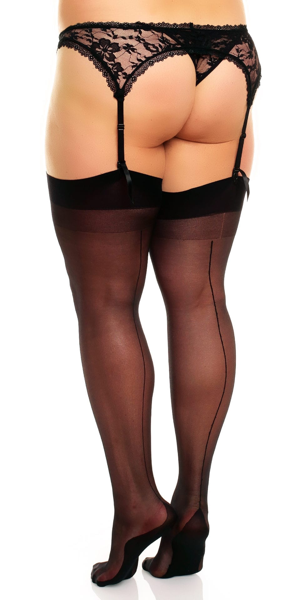 Plus size model wearing Glamory delight 20 seamed stockings in color black back view close up